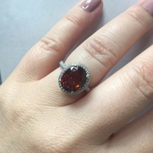18k Spessartite Garnet and pave diamond ring